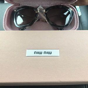 Miu miu sunglasses! New with tags. Never worn!